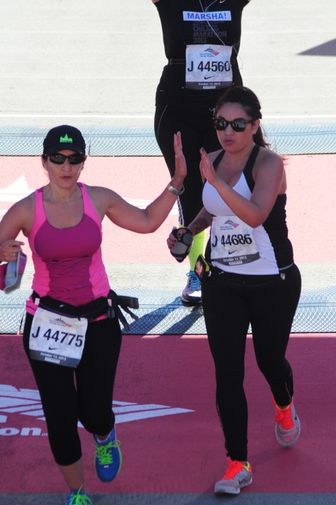 My training partner, Beth, and me at the end of the 2013 Chicago Marathon
